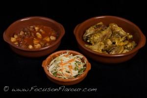Chicken with garlic and saffron; patatas bravas; cabbage, green pepper and caraway salad
